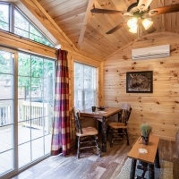 living area with patio doors inside cabin