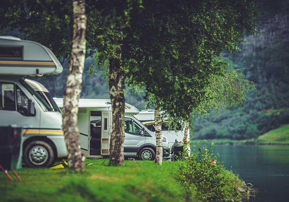 sesveral RV's parked at a camp ground